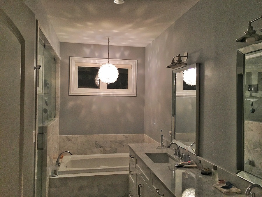 The Artesian Project Master Bath at night capiz pendant