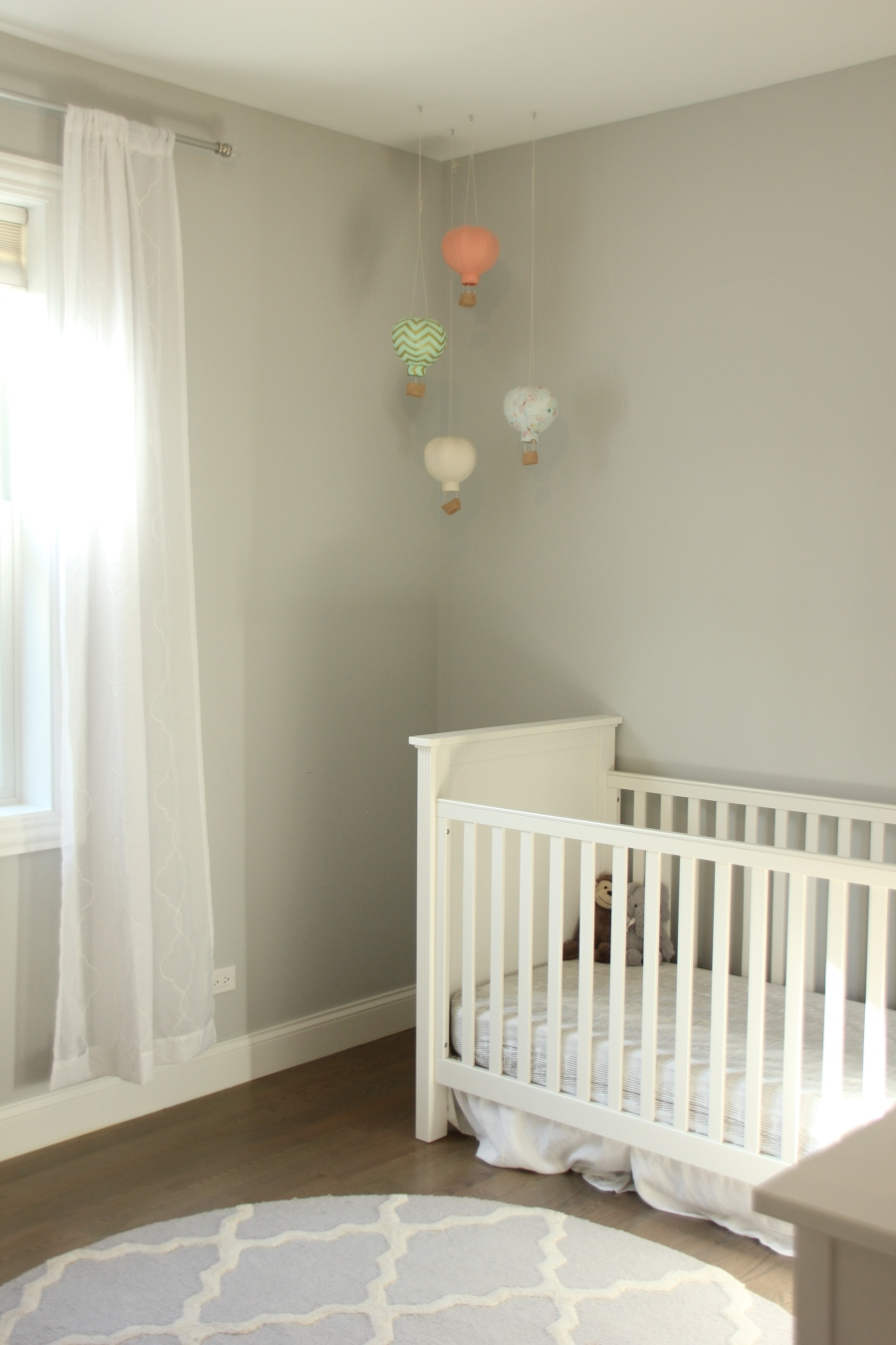 gender neutral nursery grey sherwin williams passive sw pastel hot air balloons trellis pb kids fillmore crib