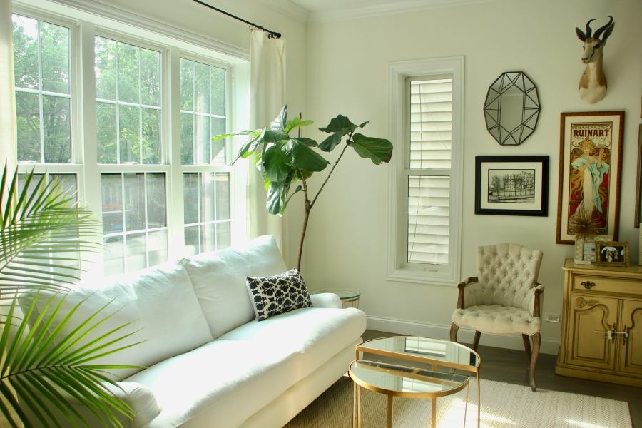 neutral living room white couch windows sofa