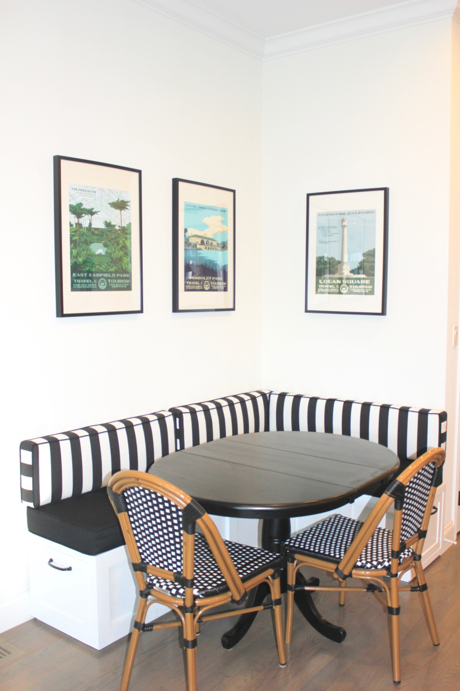 Artesian Designs | Black + White Breakfast Nook...Custom banquette, wayfair round table, one kings lane bistro chairs, chicago neighborhoods art