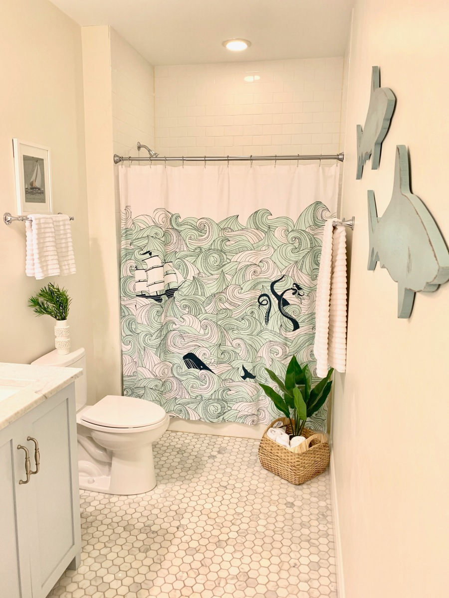 Coastal Bath Style | casual cool beach bathroom look; light blue vanity, marble hex, subway tile