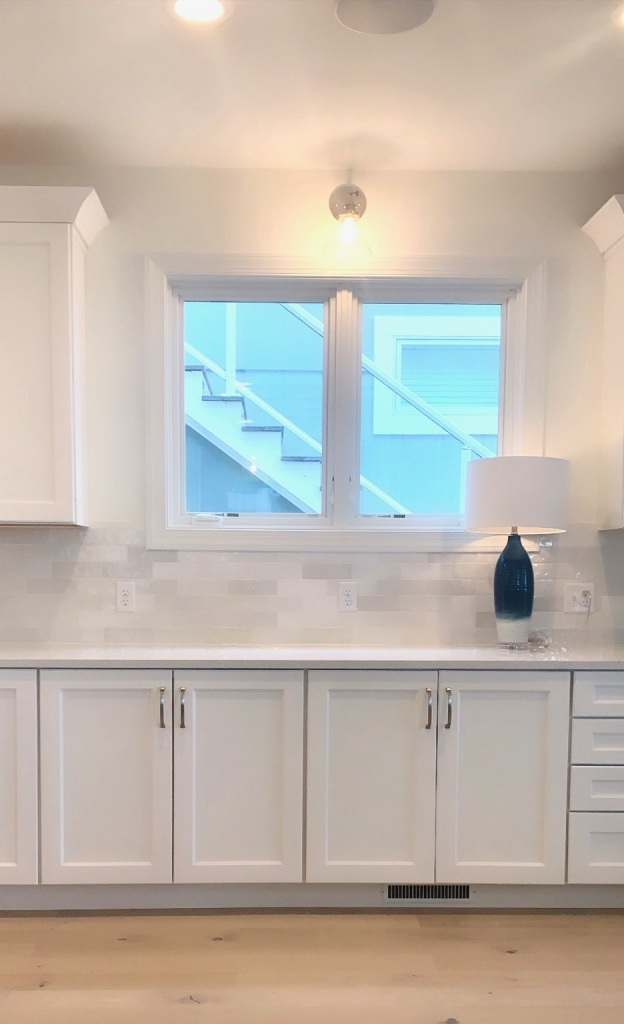 Artesian Designs | #csideproject Beach house SW Greek Villa kitchen white cabinets with wood island stuga pippi floors
