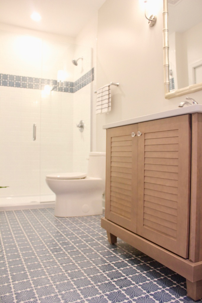 Artesian Designs | #csideproject Beach house SW Basalt Powder bathroom blue tile floor wood shutter vanity